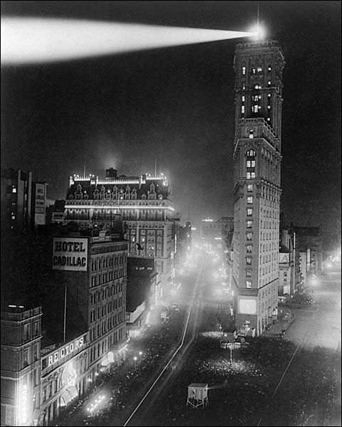Times Square, New Years Day 1908 Photo of the first year that the illuminated ball was dropped from atop the New York Times Building. It was actually dropped one minute after midnight.